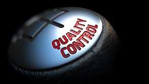 Quality Control - Red Text on Car's Shift Knob on Black Background. Close Up View. Selective Focus..jpeg
